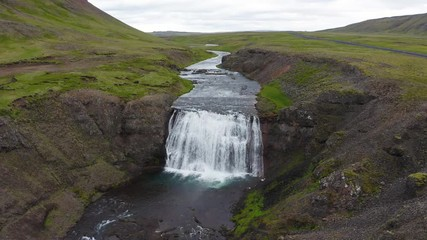 Wall Mural - Flying above the Thorufoss waterfall in Iceland