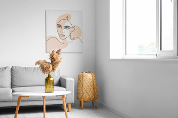Wall Mural - Stylish interior of living room with table and sofa