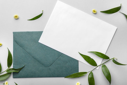 Composition with blank card and envelope on light background