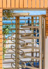 A metal rotating turnstile at a sea bath in Brighton, Melbourne, Australia