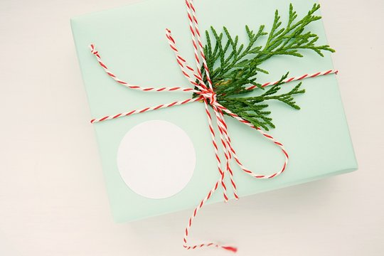 Round sticker mockup for Christmas gift, product label mockup, circle gift tag, thank you sticker on green box.