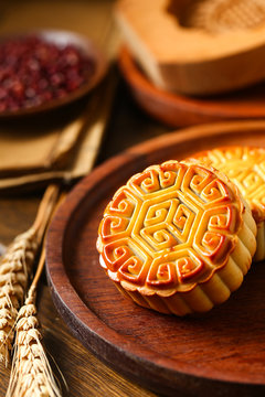 Chinese traditional mid autumn festival moon cake in wooden plate