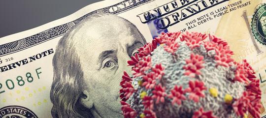 Coronavirus Covid19 on one hundred dollar bill. Economic crisis