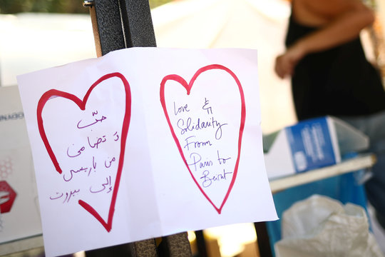 """A sign that reads """"Love & Solidarity from Paris to Beirut"""" is seen in a volunteer base camp that was set up to lead relief and rehabilitation in the aftermath of a massive explosion in Beirut port, Lebanon"""