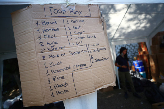 A sign listing the items of food required to make up a food box for people in need is seen in a volunteer base camp that was set up to lead relief and rehabilitation in the aftermath of a massive explosion in Beirut port, Lebanon