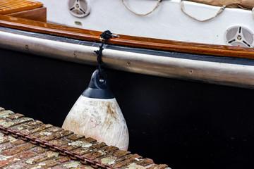 Fototapeta Detail of the traditionaj Duch boat in the sunset in Leiden, Netherlands obraz