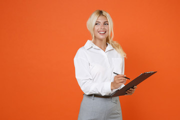 Smiling cheerful beautiful young blonde female business woman girl wearing white shirt posing hold...