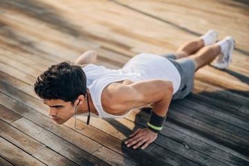 Young man doing push-ups exercise