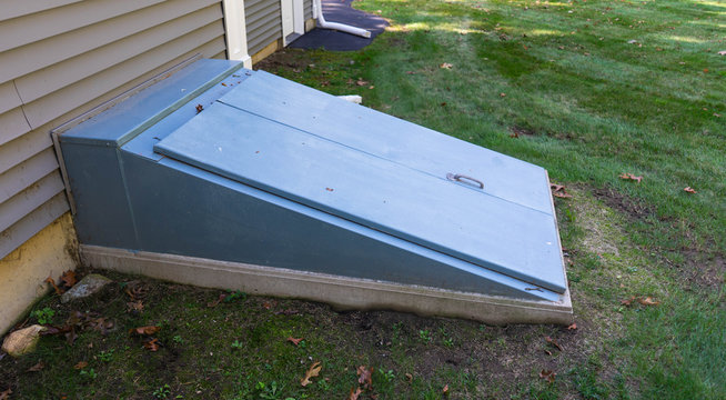 Storm cellar doors closed on side of house