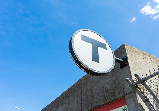 Boston MBTA sign for the Red Line T stop at UMASS Boston.
