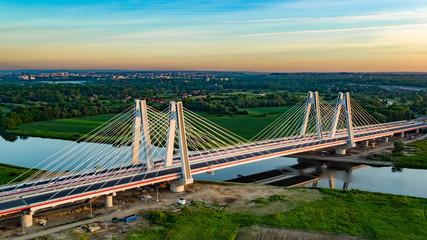 Fototapeta most na rzece z panoramą miasta obraz