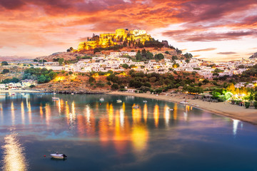 Wall Mural - Landscape with beach and castle at twilight time in Lindos village of  Rhodes, Greece