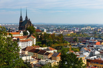 Autumn cityscape of Brno with famous gothic Cathedral of Saints Peter and Paul on sunny day, Czech Republic