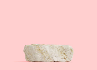 Stone podium for display product on pink background.