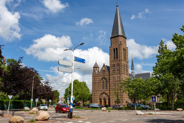 The historical Roman Catholic Sint-Pancratius church on the crossing of the Hoofdstraat and the Parklaan in the South-holland village of Sassenheim in the Netherlands.