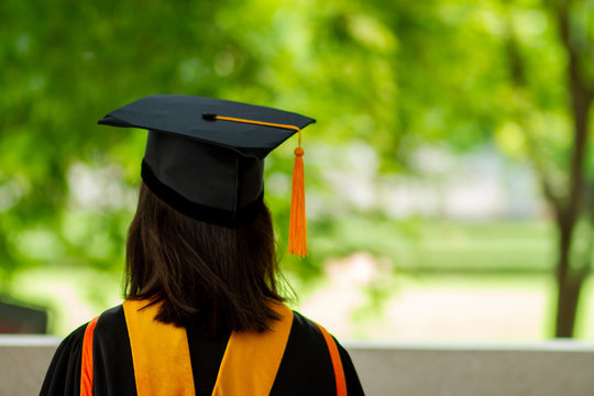 A black hat with a yellow tassel from a university graduate.