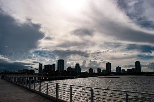 Silhouette view of the downtown St. Pete skyline on a beautiful cloudy day from the pier.