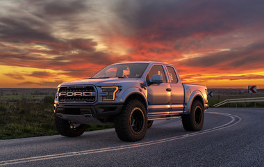 Ford F-150 Raptor - Most Extreme Production Truck On The Planet standing on the road at sunset