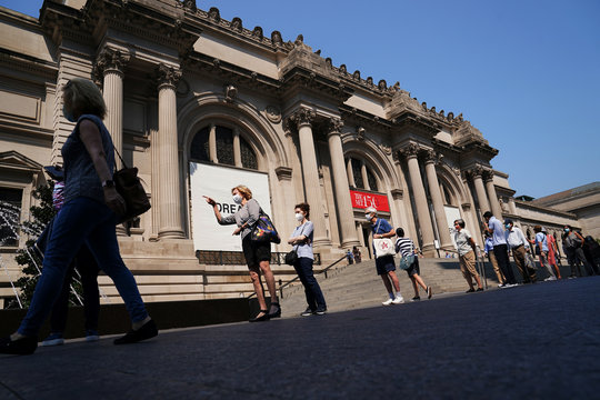 People line up to attend The Metropolitan Museum of Art on their first day open since closing due to the coronavirus disease (COVID-19) outbreak