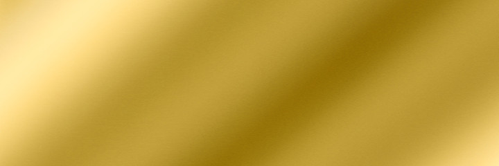Golden metallic polished surface Golden metallic polished surface. Long brushed texture with shiny light reflections for a background. Space for text.