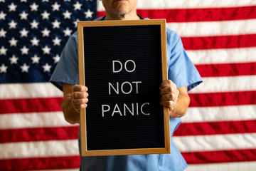 Health: Doctor With Letterboard DO NOT PANIC