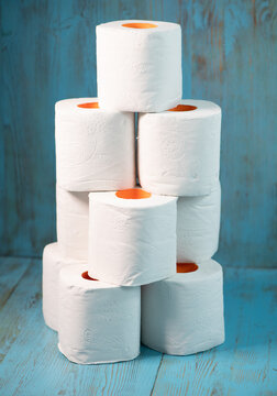 rolls of toilet paper from a large stack