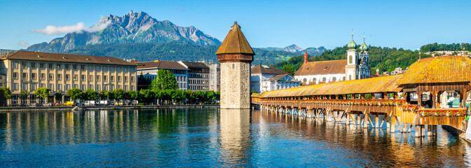 Scenic panoramic view of Lucerne with Chapel bridge or Kapellbrucke and Pilatus mount with clear...