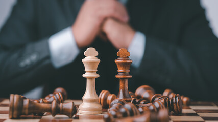 Businessman Analyze chess piece on chess board game concept for ideas and competition and strategy, business success concept, business competition planing teamwork strategic concept.