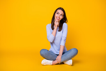 Portrait of her she nice attractive brainy smart clever cheerful girl sitting lotus position thinking making decision copy space clue guess isolated bright vivid shine vibrant yellow color background