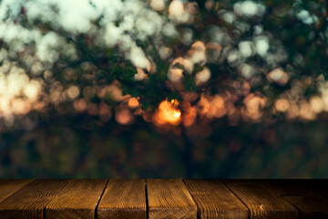 Photo sur Plexiglas Ponts Empty wooden deck table with foliage bokeh background. Ready for product display montage.