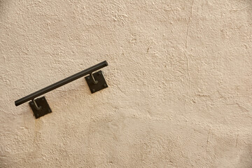 Small railing screwed into a wall