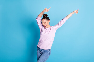 Portrait of her she nice attractive pretty cheerful cheery glad girl dancing celebrating having fun weekend isolated over bright vivid shine vibrant blue color background