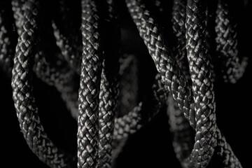 Aluminium Prints Black twisted rope on a black background