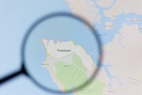 Moscow / Russia - 04.04.2019: Freetown, Sierra Leone, city map visualization. Illustrative editorial concept visible on monitor screen through a magnifying glass