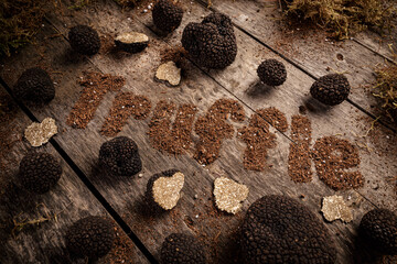 Black truffles on the old wooden table