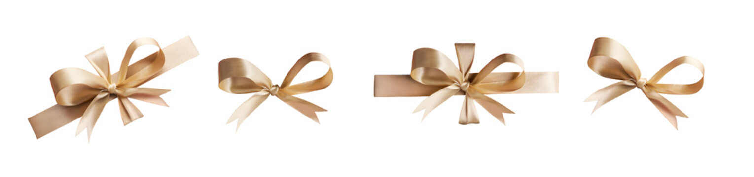 A collection of gold ribbon bows for Christmas, birthday and valantines presents isolated against a white background
