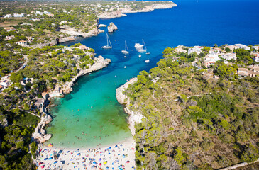 aerial view of a beautiful white sandy beach on Mallorca, Cala Llombards, Spain