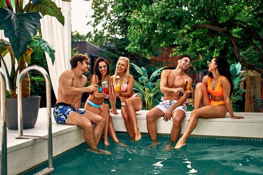 Friends near swimming pool