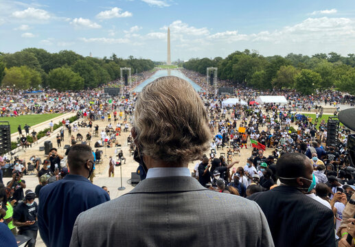 "Rev. Al Sharpton looks out at the ""Get Your Knee Off Our Necks"" Commitment March on Washington 2020 in support of racial justice in Washington"