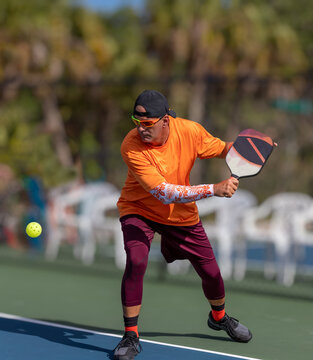 Pickleball pro prepares to slice ball using a backhand