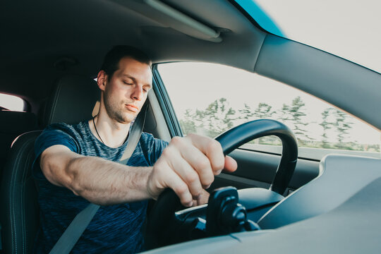 Tired driver falls asleep while driving car. Sleepy man wearing seat belt in vehicle. Risk of accident due to alcoholic intoxication. Unsafe driving from fatigue or drunkenness