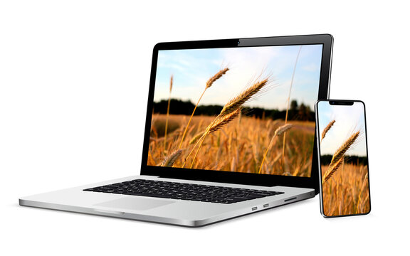 Modern laptop computer with smartphone isolated on white