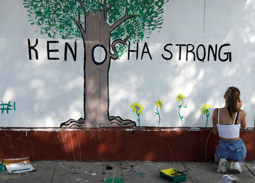 A person paints a mural following the police shooting of Jacob Blake, in Kenosha