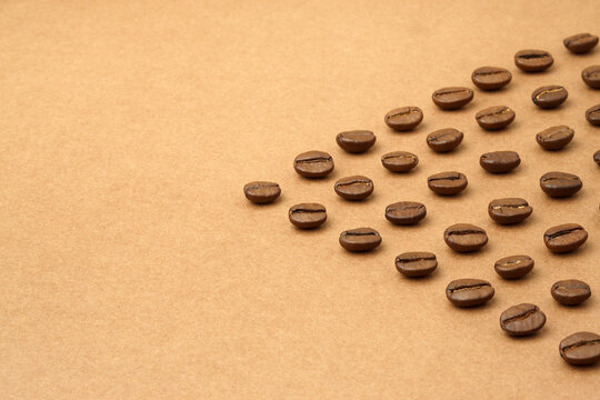 Coffee beans in the shape of a pointer or arrow