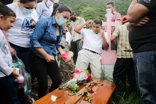 A woman cries next to the coffin with the remains of Nicaraguan migrant Eleazar Blandon, who died of heatstroke in a Spanish watermelon field, during his funeral service Jinotega