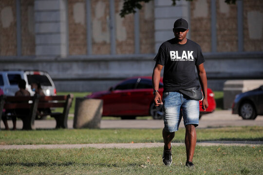 A man is pictured wearing a Black Lives Activist of Kenosha t-shirt, following the police shooting of Jacob Blake, a Black man, in Kenosha, Wisconsin