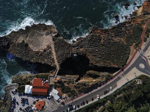 Cliffs in Cascais, beautiful coastal city in Portugal near of Lisbon. Europe. Aerial Drone Photo