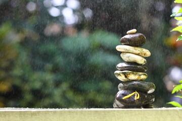zen garden with stones with rainy drop background