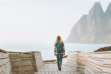 Woman traveler exploring Norway travel solo summer vacations active healthy lifestyle outdoor Okshornan peaks landscape Senja islands
