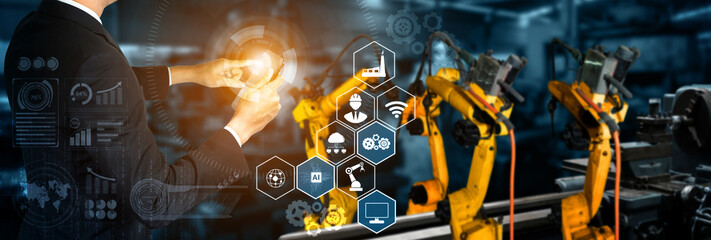 Smart industry robot arms for digital factory production technology showing automation manufacturing process of the Industry 4.0 or 4th industrial revolution and IOT software to control operation .
